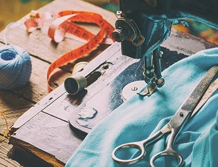 Old vintage hand sewing machine. Sewing clothes at home