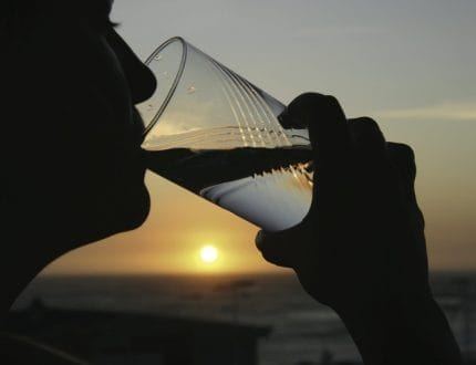 Drinking Water Against Sunset